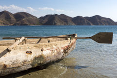 Old wooden fishing boat on the beach of Taganga Stock Photo