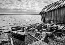 Old wooden fishing boat on lake coast Stock Photo