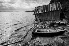 Old wooden fishing boat on lake coast Stock Image
