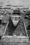 Old wooden fishing boat on lake coast Royalty Free Stock Image