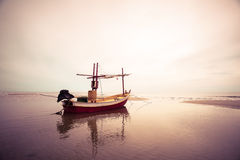 Old wooden fishing boat landing on the beach, Royalty Free Stock Photography