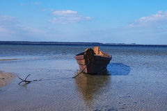 Old wooden fishing boat near the shore Stock Images