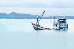 Old wooden fishing boat shipwreck submerged in the sea. In the morning stock image