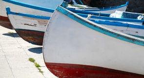 Old wooden fishing boats are laying on the sea coast Royalty Free Stock Images
