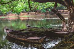Old wooden fishing canoe, Siem Reap, Cambodia. Stock Images