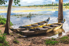 Old wooden fishing canoe, Siem Reap, Cambodia. Royalty Free Stock Images