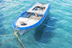Old wooden fishing red boat tied on dock. Close Royalty Free Stock Photography