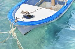 Old wooden fishing red boat tied on dock. Close Royalty Free Stock Photos