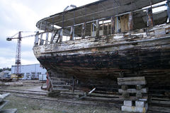 Old wooden fishing ship on reconstruction in docks Stock Image
