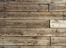 Old wooden floor. Heavily-used wooden pier in fishing village in Norway stock photography