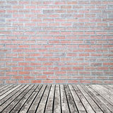 Old wooden floor on brick wall grung background Royalty Free Stock Photo