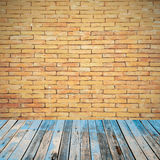 Old wooden floor on brick wall grung background Stock Images
