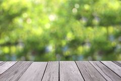 Old wooden floor with green blur background. Old plank with blurred background royalty free stock images