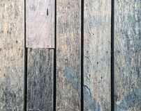 Old wooden floor with grooves. The old wooden floor surface has been used for a long time royalty free stock photo