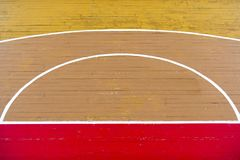 Old wooden floor volleyball, basketball, badminton court with light effect Wooden floor of sports hall with marking lines line on royalty free stock images