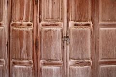 Old wooden folding doors, Chiang Khan, Thailand royalty free stock image