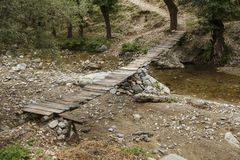 Old wooden foot bridge. In a village in Romania Stock Photos