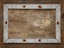 Old wooden frame. On brown dirty aged wall Stock Image