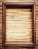Old wooden frame. On wood background Stock Image