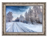Old wooden frame with beautiful winter landscape. Isolated on white background. Photo inside is my property Stock Image