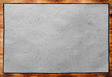 Old wooden frame with blank paper, retro message board. Royalty Free Stock Photography