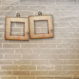 Old wooden frame on the brick wall background Stock Photos