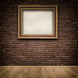 Old wooden frame on bricks wall. Royalty Free Stock Image
