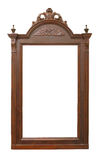 Old wooden frame with carvings. Beautiful and old wooden frame for mirrors decorated with carvings and ornaments Stock Image