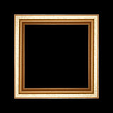 Old wooden frame isolated on black background. Royalty Free Stock Image