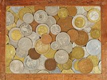Old wooden frame with numismatic coins collection inside.Backgro. Old wooden frame with numismatic coins collection inside as abstract background Royalty Free Stock Images