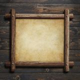Old wooden frame with paper or parchment on wood background 3d illustration. Old wooden frame with paper or parchment on wood table or wall Stock Image
