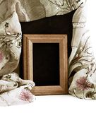 Old wooden frame with silk textured cloth Stock Photos