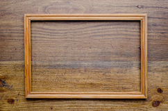 Old wooden frame on wood background Royalty Free Stock Photos