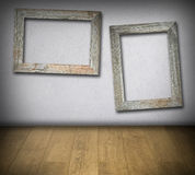 Old wooden frames on concrete wall Stock Image