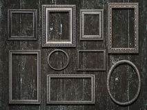 Old wooden frames on vintage  wooden background Stock Photography