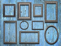 Old wooden frames on vintage  wooden background Royalty Free Stock Photography