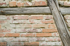 Old wooden framework. Background of an old brick wall with decaying timber framing Royalty Free Stock Photos
