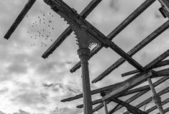 The  old wooden framework of ruin building.  Stock Photos