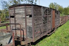Old wooden freight wagon. Part of destroyed train Royalty Free Stock Photography