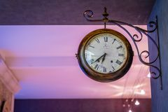 Old french clock. Old wooden french clock on a wall Royalty Free Stock Photography