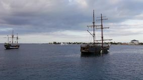 Old wooden frigates are tendered at Grand Cayman Island stock footage