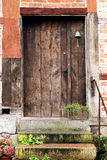 Old wooden front door in a historic half timbered house Stock Image