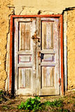 The old,wooden front door with a padlock Royalty Free Stock Photography