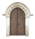 Old wooden front door. With stone portal isolated on whitewith clipping path Stock Photo