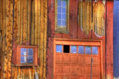 Old wooden garage. Exterior of old wooden garage with missing window pane Royalty Free Stock Image