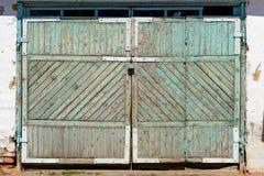 Old wooden garage doors with padlocks.  Stock Image