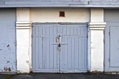 Old wooden garage gate. Old locked wooden garage door in Saint-Petersburg, Russia Stock Image