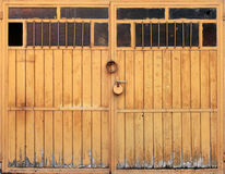Old wooden garage gate with padlock, texture Stock Images