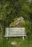 Old wooden garden bench. Old, white, wooden garden bench Royalty Free Stock Images