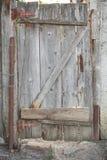 Old wooden garden door. Old dilapidated patched  wooden garden door Royalty Free Stock Image